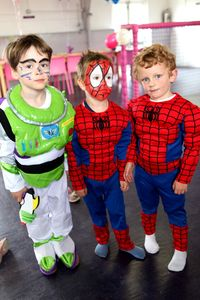 A group of three children in costume at Pixie's Party.